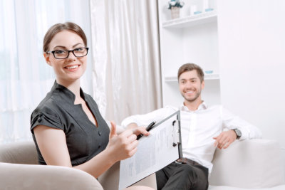 female counselor and adult man smiling