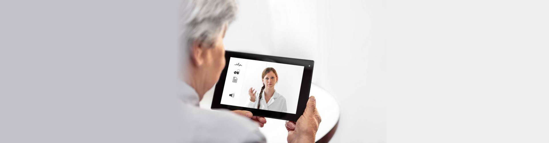 Telemedicine or Telehealth with a Doctor and a senior women with tablet