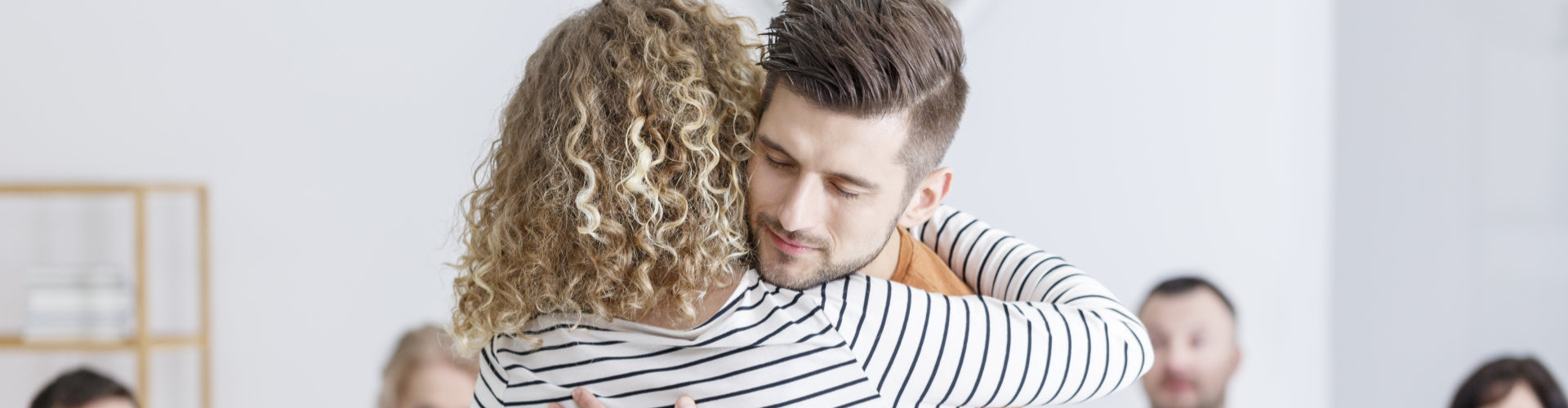 therapist hugging an adult man